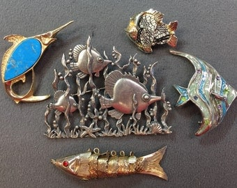 Four Fish Brooches-one signed JJ-and One Articulated Fish Pendant