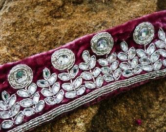 Pink rhinestones outlined with zardosi silver threads on velvet fabric