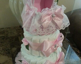 Two Tier Pink And White Diaper Cake With Carriage Cake Topper