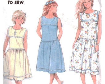 Simplicity Sewing Pattern 7200 Girl's Pullover Dress in two lengths  Size:  N  10-14  Used