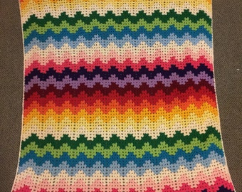 Rainbow crochet blanket. Beautiful addition to any home.