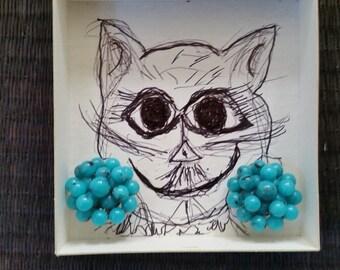 Cat Wearing Blue Earrings MEOW