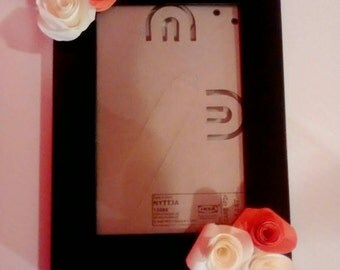 Wooden frame with paper flowers