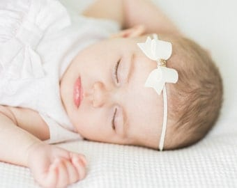 Gorgeous Cream 100% Wool felt hair and gold glitter mini bow on cream skinny elastic headband