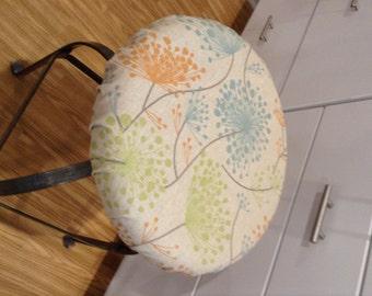 Rustic Irish Daisy floral print linen fabric elasticized round barstool cover, orange blue gray & green on linen, washable cotton fabric