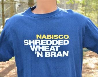 80s T-Shirt Nabisco Shredded Wheat More of the Best Breakfast Cereal Hi Cru Stedman Large Navy Blue Tee