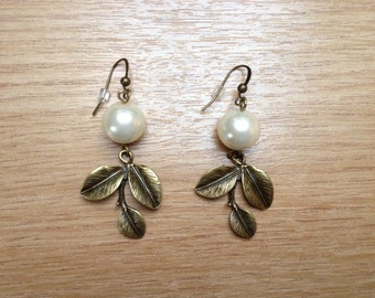 Dangle earrings, copper coloured leaf with glass pearl