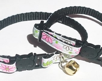 Adjustable breakaway cat collar, pink and white floral in adult or kitten sizes.
