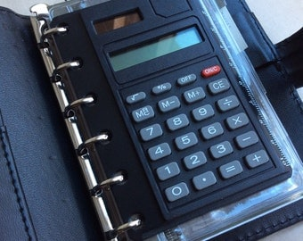 Vintage 80s 90s personal organiser with calculator.