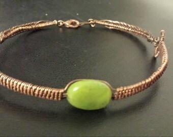 Copper bracelet with jade cabochon