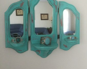 Distressed turquoise painted mirror