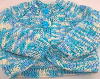 """SALE ITEM.Soft hand knitted blue and white bolero, to fit approx 3-6 months. Baby sweater to fit 16""""(41cms)chest. 3 button fastening."""