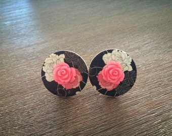 Nice big earrings with a beautiful red rose