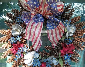 Patriotic Pinecone Wreath made of natural pinecones and silk flowers. Pinecones sourced home in NE Ohio make a lovely Wreath!