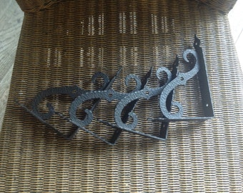 Set of 4 cast iron stands for shelves
