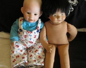 Pair of Handmade Porcelain Boy Dolls