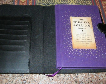 Black planner with Fortune Telling Book