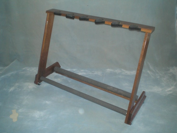 6 space American Walnut guitar rack for acoustic and/or electric guitars w/ optional wheels and security straps.