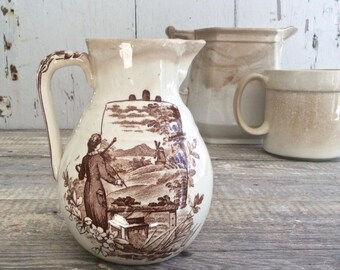 Antique brown transferware pitcher with unusual plein air landscape scene