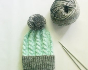 Hand Knitted Cable Twist Cuffed Infant Hat With Pom Pom