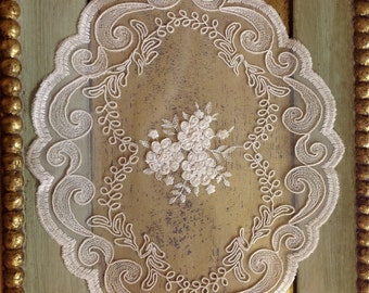 Tulle embroidered doily with rebrode