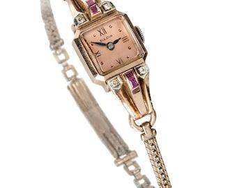 Retro 14k rose gold diamond ruby Bulova woman's watch