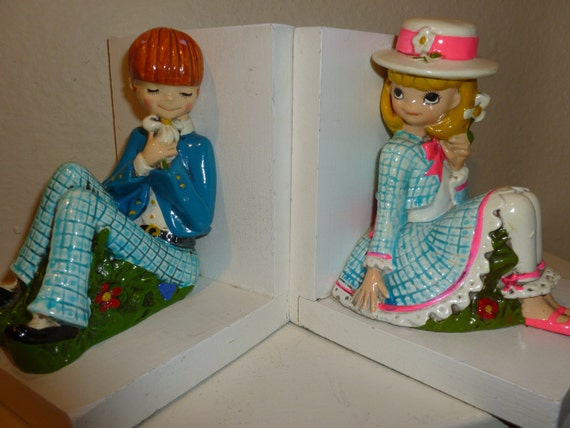 Vintage boy and girl bookends from the s