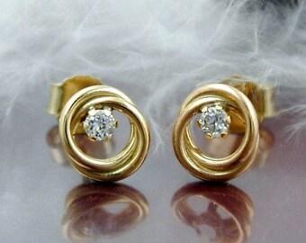 Studs interlocking rings, 9K GOLD