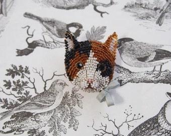 A tortoiseshell cat  brooch