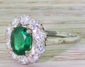 Late 20th Century 1.43 Carat Colombian Emerald & Diamond Cluster Ring, dated 1974