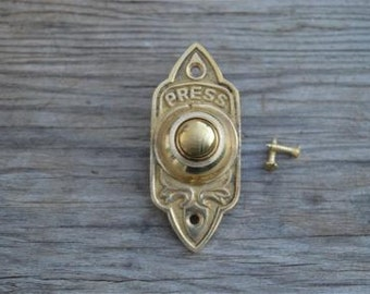 A Victorian Gothic revival style brass door bell CB7