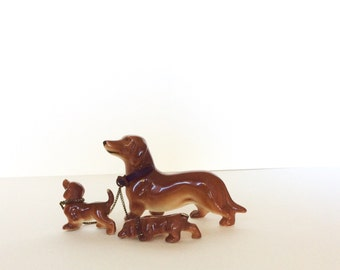 Goebel Hummel. Goebel dachshund miniature collectible figurine. Dachshund goebel dog with puppies. Dachshund dog. Miniature figurines. Dog