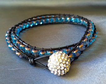 Double wrap fire polished crystal bracelet with rhinestoned button