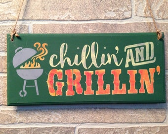 Chillin' and Grillin',Barbecue,outdoor barbeque get togethers,BBQ pit,barbecue area,Grilling steaks,family barbeques,bbq parties,Master chef