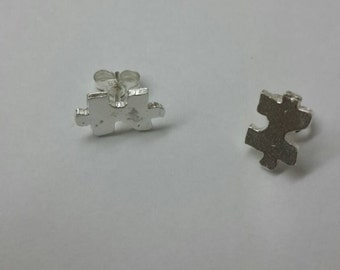 Silver puzzle stud earrings