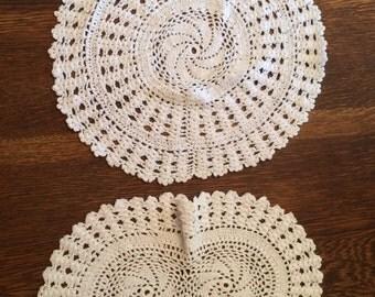 2 white doilies