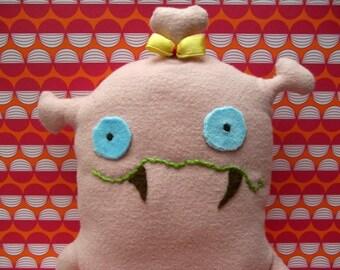 Cuddly pink monster girl