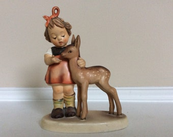 This is a Darling Hummel Goebel Girl with a Fawn/Deer Figurine, 'Friends' Animal Collection Series.