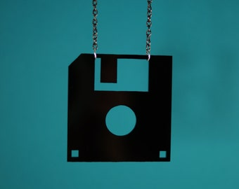 Acrylic floppy disk necklace.