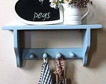 Shelf with peg rail for coats or towels