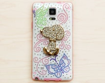 Galaxy Note 4 smartphone case Unique Handmade. Rhinestones: blue green butterflies pink swirls. Snoopy charm. Pink border Clear durable soft