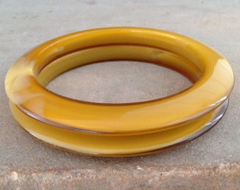 Pair of Sleek Vintage Amber Colored Bangles