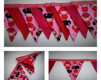 Bunting,colourful girl print fabric in pinks and red.2 metres.colourful decoration.