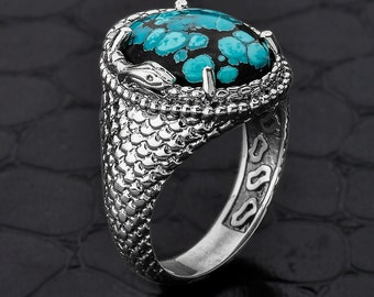 Ouroboros Snake ring with New Mexico Turquoise stone. High polish oxidized. New Mexican turquoise stone . Sterling silver Ouroboros snake .