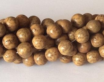 """Yellow Betel Nut Beads Salwag 10mm Round 16"""" strand"""