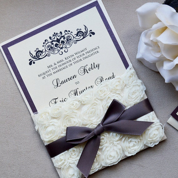 KELLY - Rosette Lace Wedding Invitation - Ivory Pocket Invitation - Wedding Invitation with Eggplant Purple Ribbon & Swarovski Crystals