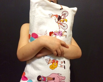 Pillow with organic buckwheat hulls for children with drawings of children and animals in the circus