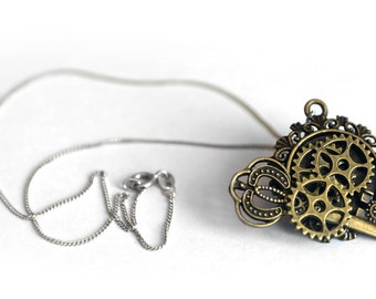 Steampunk necklace pendant with vintage key, cameo, cog wheels gears