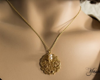Oriental ornament with Pearl on gold filled