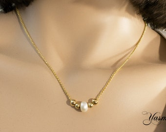Pearl with gold-plated balls